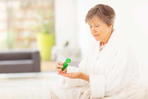 Senior Woman Taking Pills Stock Photo - Download Image Now
