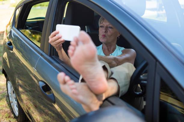 Senior woman taking selfie on mobile phone stock photo