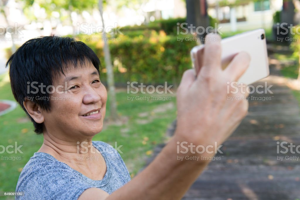 Senior woman taking selfie stock photo