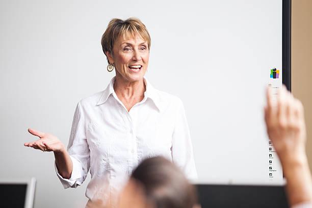 Senior Woman Teaching Adult Learning Class stock photo