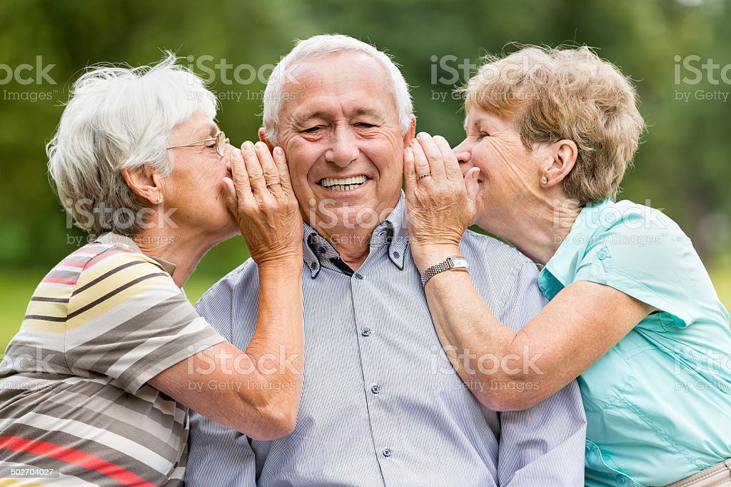 Senior Woman Telling Secrets stock photo