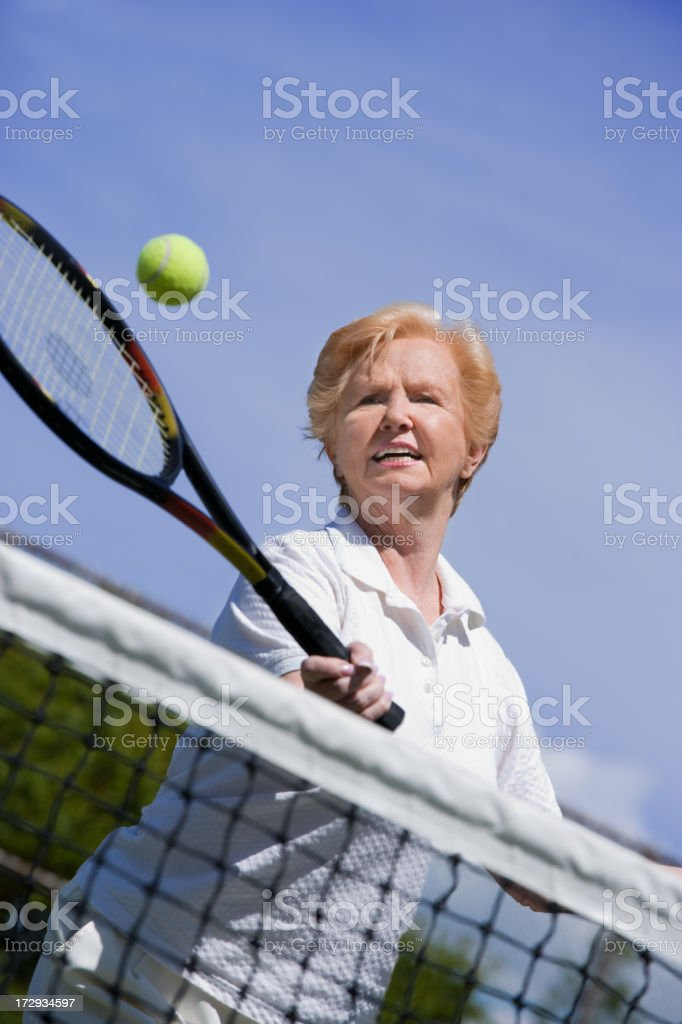 senior woman tennis volley royalty-free stock photo
