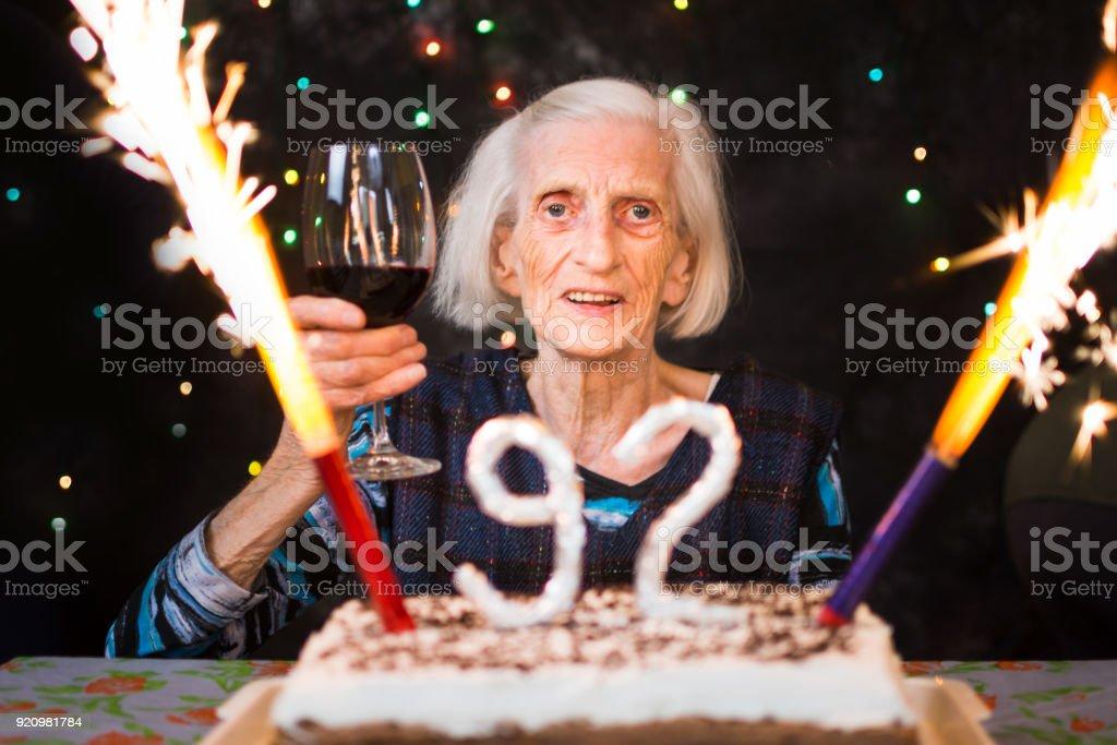 Senior woman toasting on her birthday party royalty-free stock photo