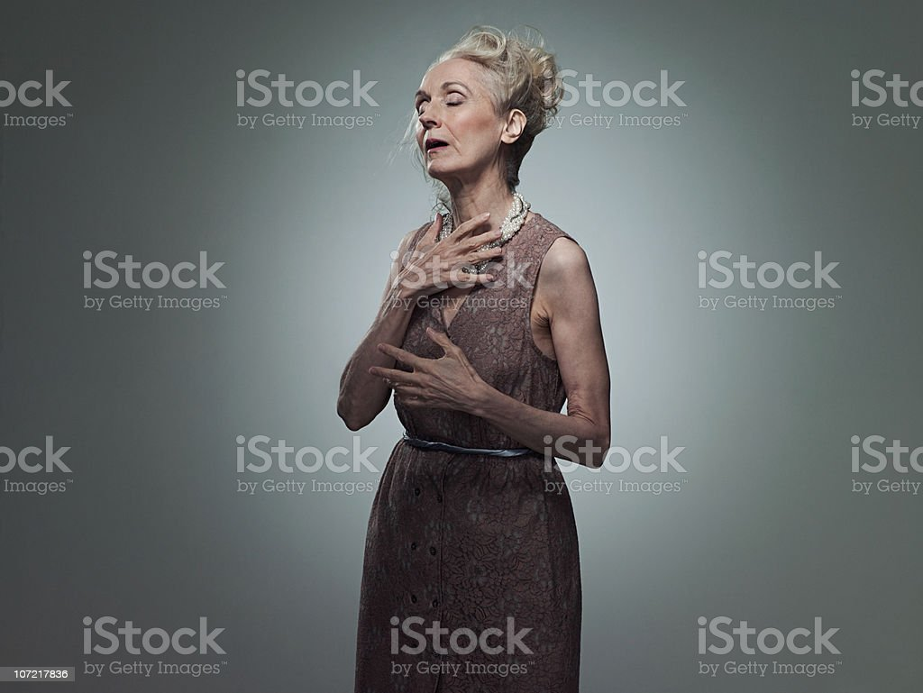 Senior woman touching chest, portrait royalty-free stock photo