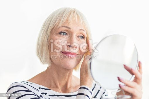 istock Senior woman touching her soft face skin 1093956978