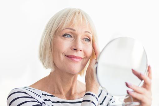 istock Senior woman touching her soft face skin 1093956978