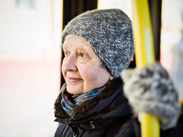 Senior woman traveling by bus stock photo