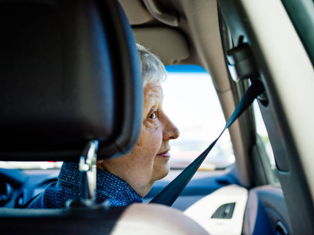 Senior woman traveling by car stock photo