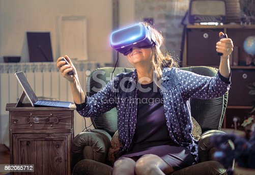 istock Senior woman trying virtual reality headset 862065712