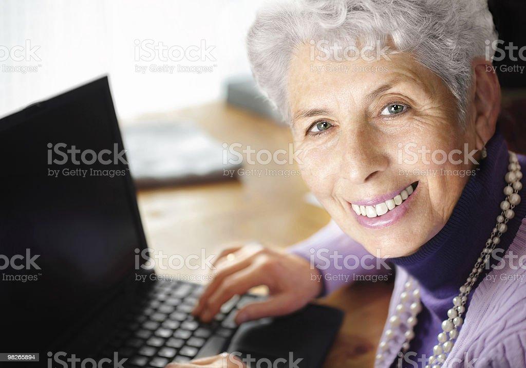 Senior woman  typing on laptop royalty-free stock photo