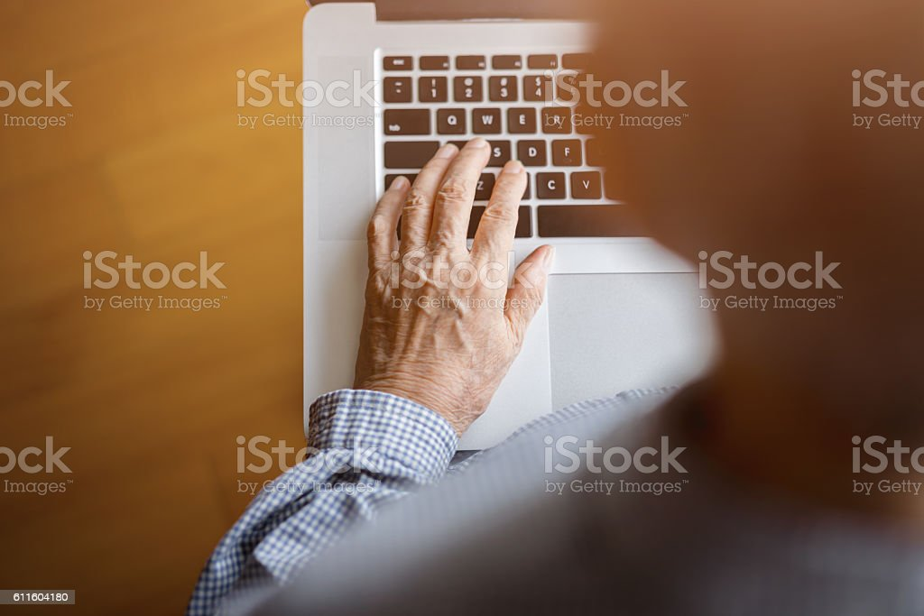 Senior Woman Using a Laptop stock photo