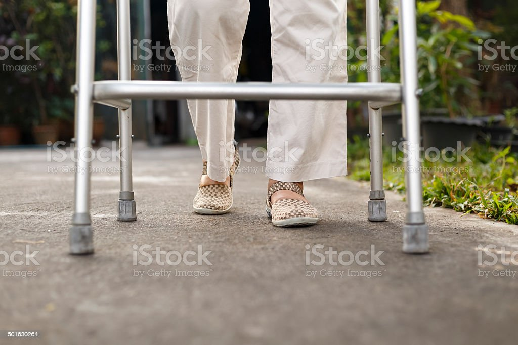 senior woman using a walker at home. stock photo