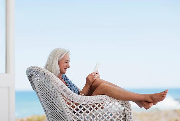 Senior woman using digital tablet in chair picture id116377234?b=1&k=6&m=116377234&s=612x612&w=0&h=1vwnyqegcauumkh6ezlxpos4jmvsatuu0jnnfznqp5c=