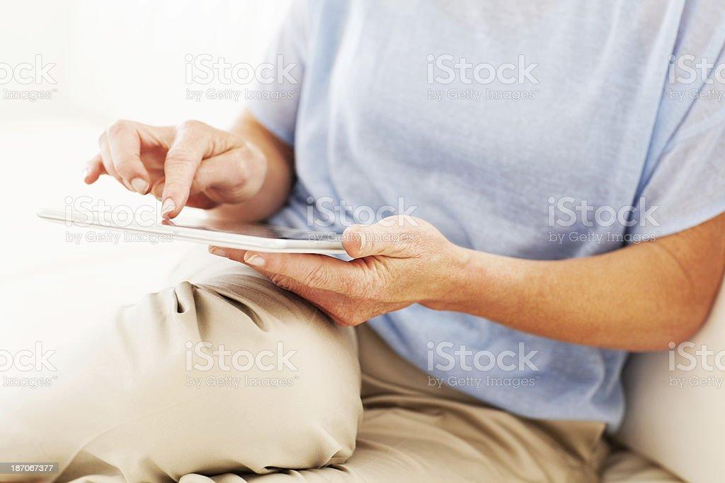 Senior Woman Using Digital Tablet royalty-free stock photo