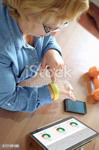 istock Senior woman using health technology 512109186