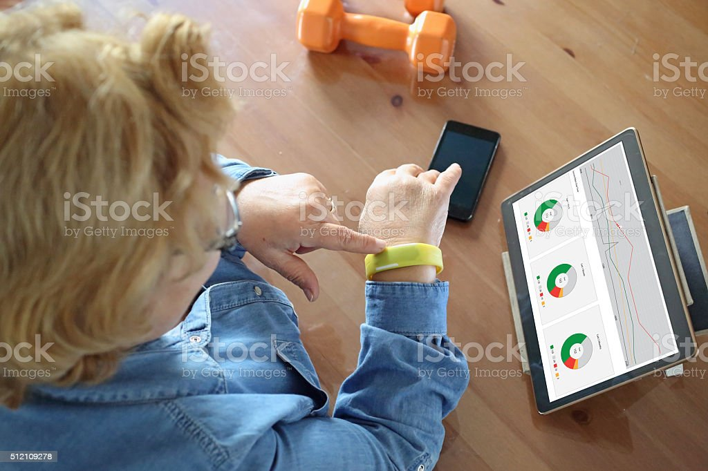 Senior woman using health technology stock photo