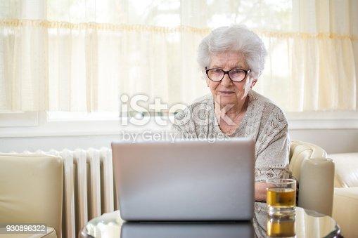 istock Senior woman using laptop at home. 930896322