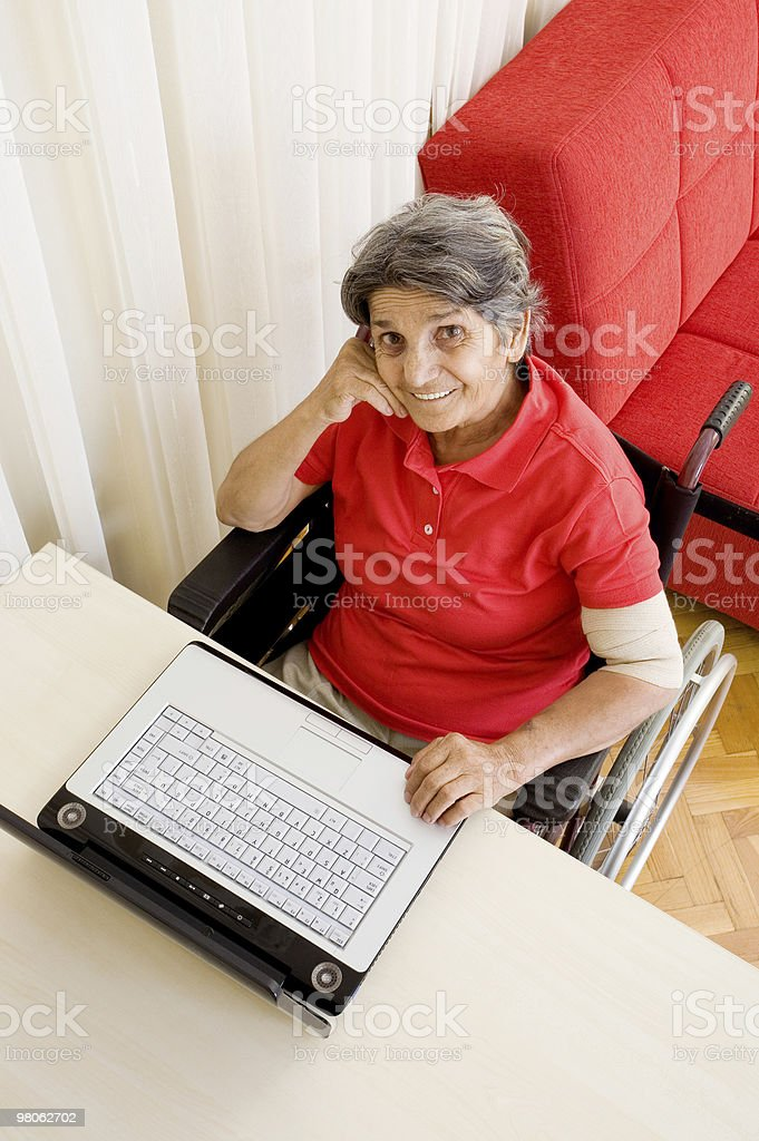 Senior woman using laptop royalty-free stock photo