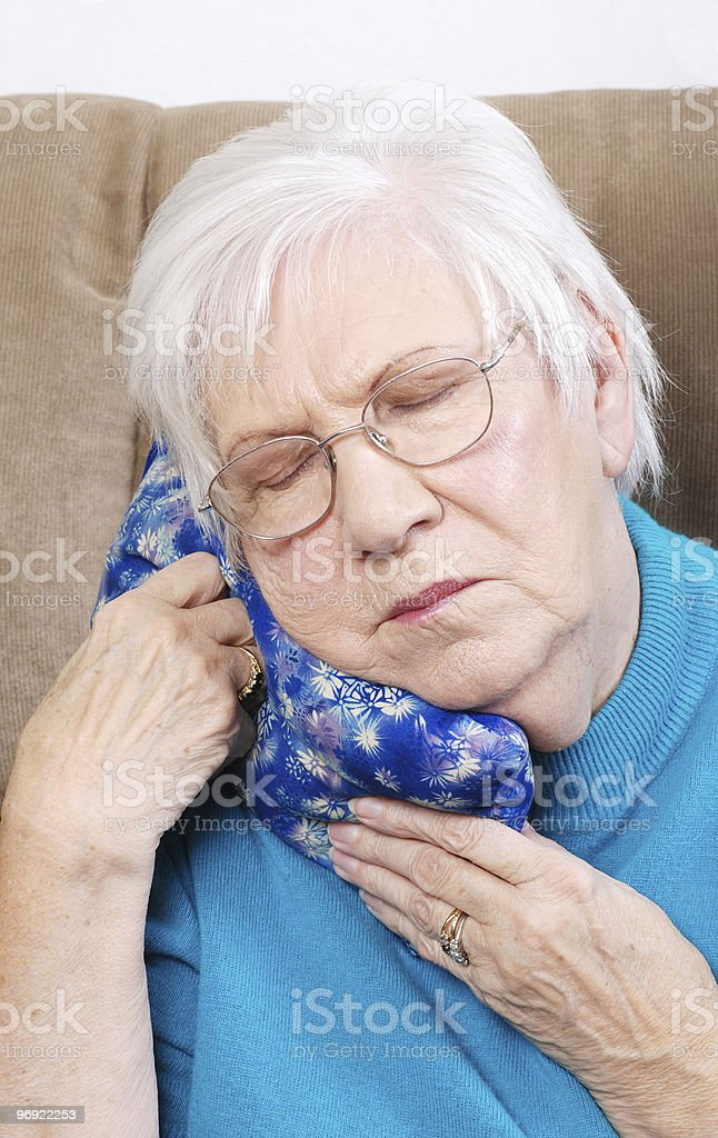 Senior Woman Using Medical Herb Hot Pack royalty-free stock photo