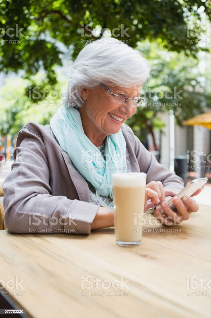 Senior woman using mobile phone royalty-free stock photo