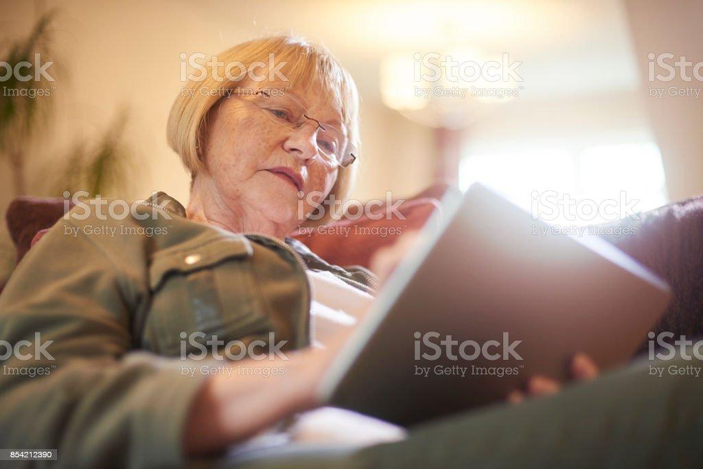 Senior woman using modern technology stock photo