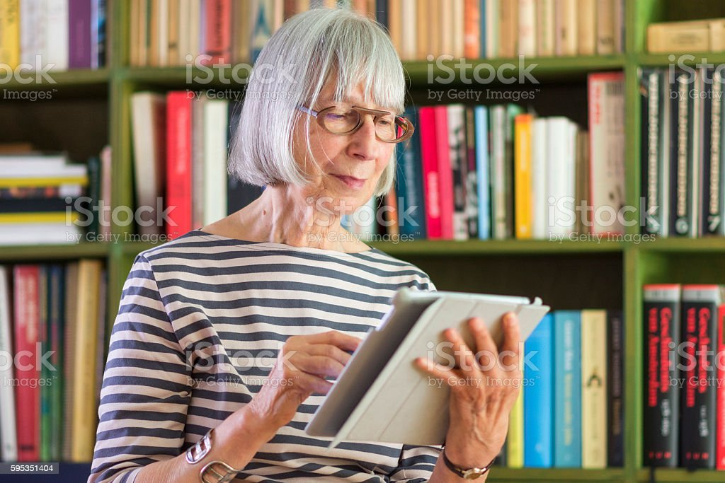 Senior woman using tablet computer stock photo