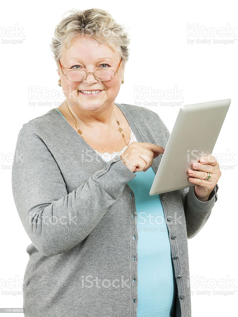 Senior Woman Using Tablet (Isolated on White) royalty-free stock photo