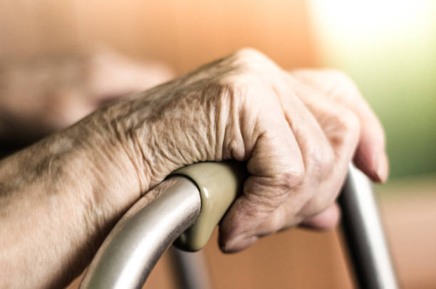 senior woman using walking frame - fragility stock pictures, royalty-free photos & images