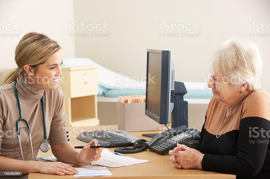 Senior woman visiting Doctor stock photo