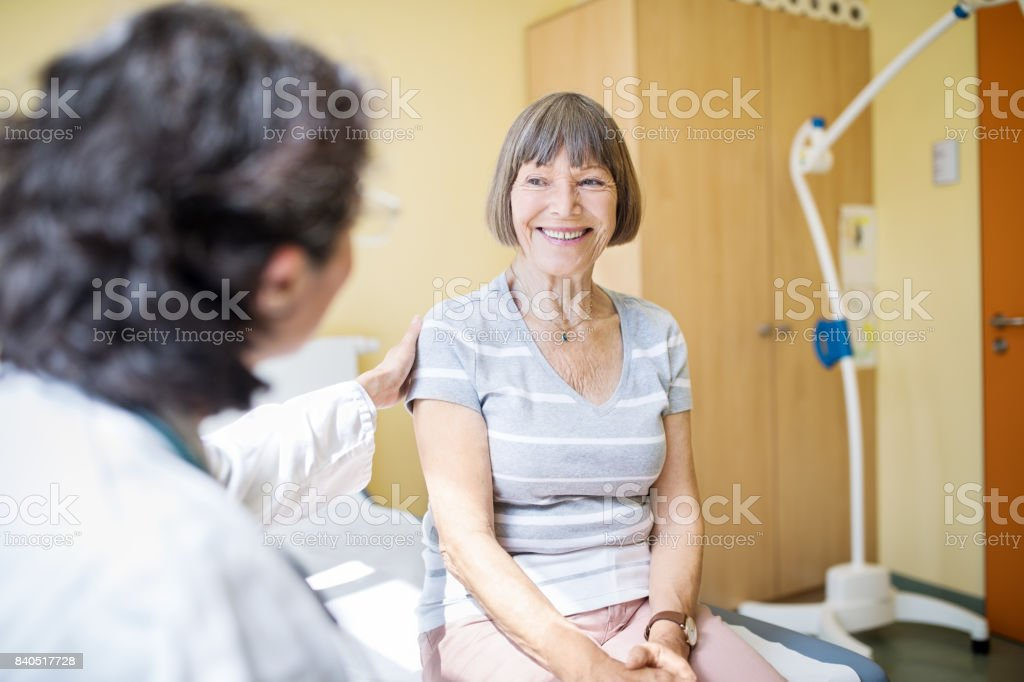 Senior woman visiting hospital for health checkup stock photo