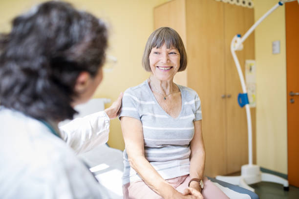 senior woman visiting hospital for health checkup - doctor visit stock photos and pictures