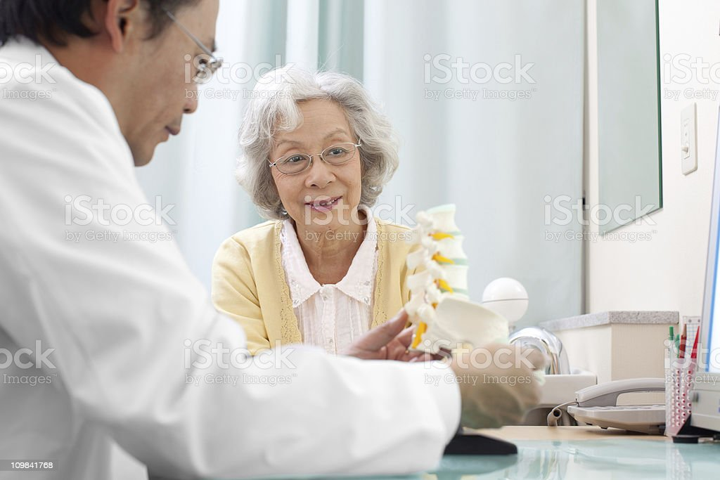 Senior woman visiting the doctor stock photo