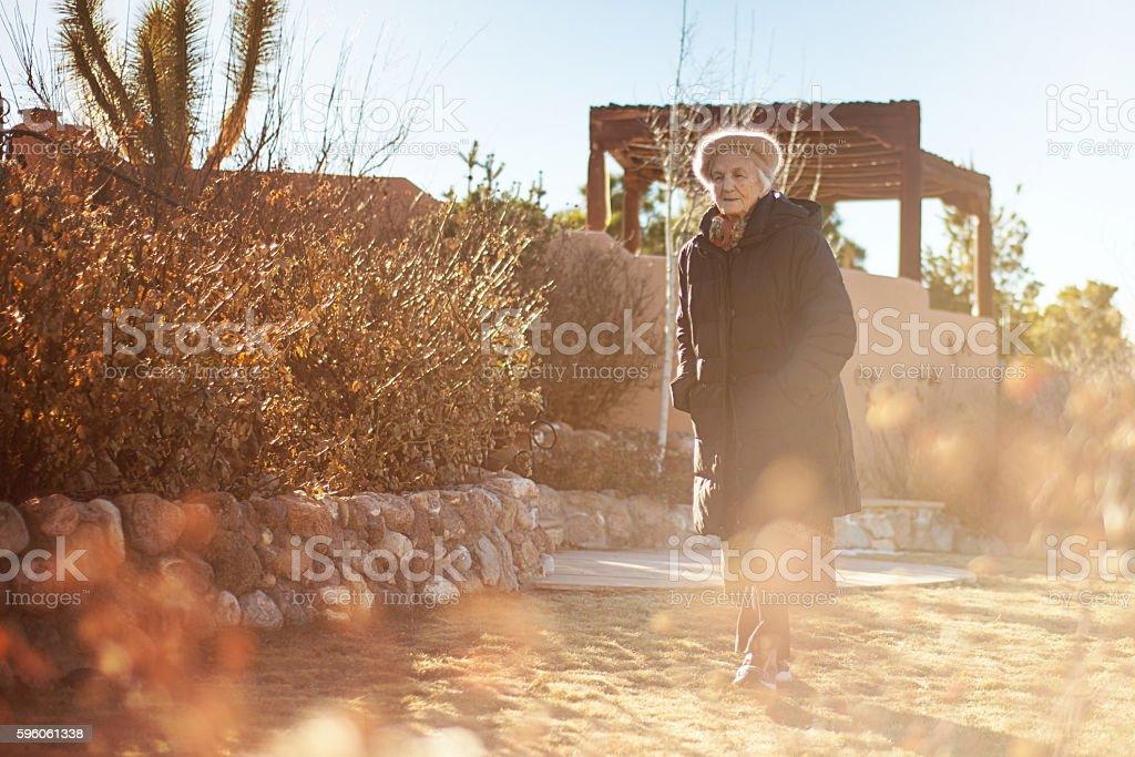Senior Woman Walking in Park,  Pensive Look royalty-free stock photo
