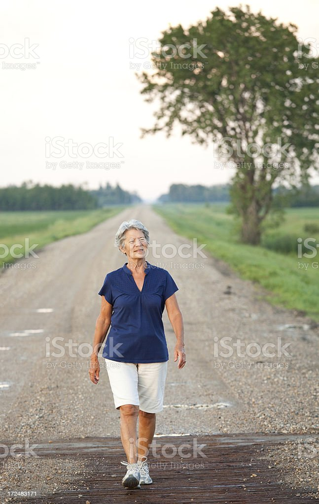 Senior Woman Walking in the Country royalty-free stock photo