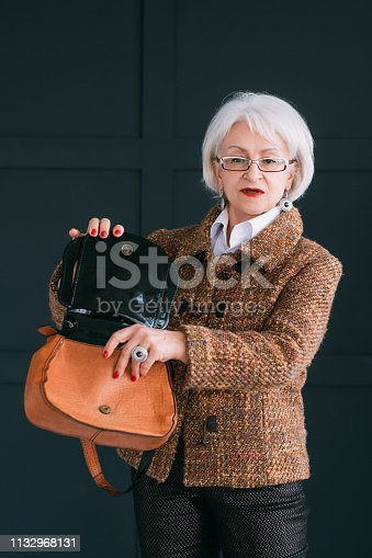 istock senior woman wardrobe style fashion shopping bag 1132968131