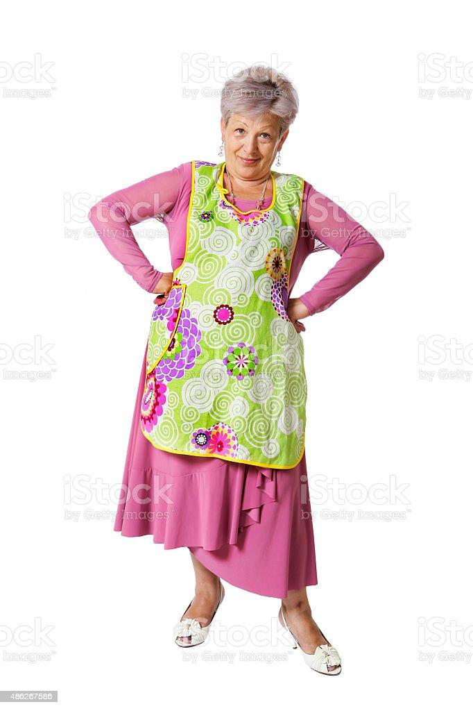 Senior woman wearing an apron isolated on white stock photo