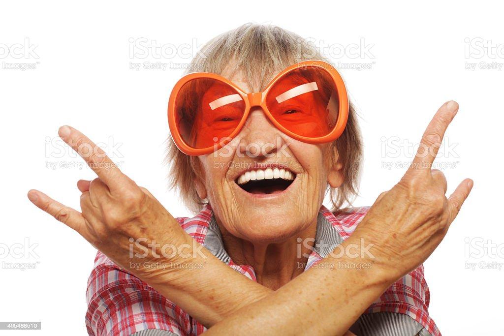 Senior woman wearing big sunglasses stock photo
