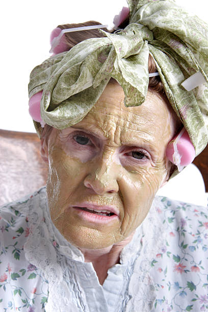 senior woman wearing curlers in hair - crotchety stock pictures, royalty-free photos & images