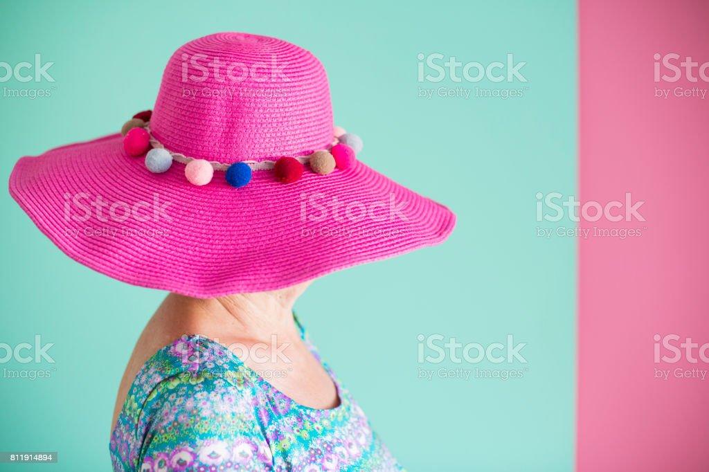 Senior woman wearing pink hat stock photo