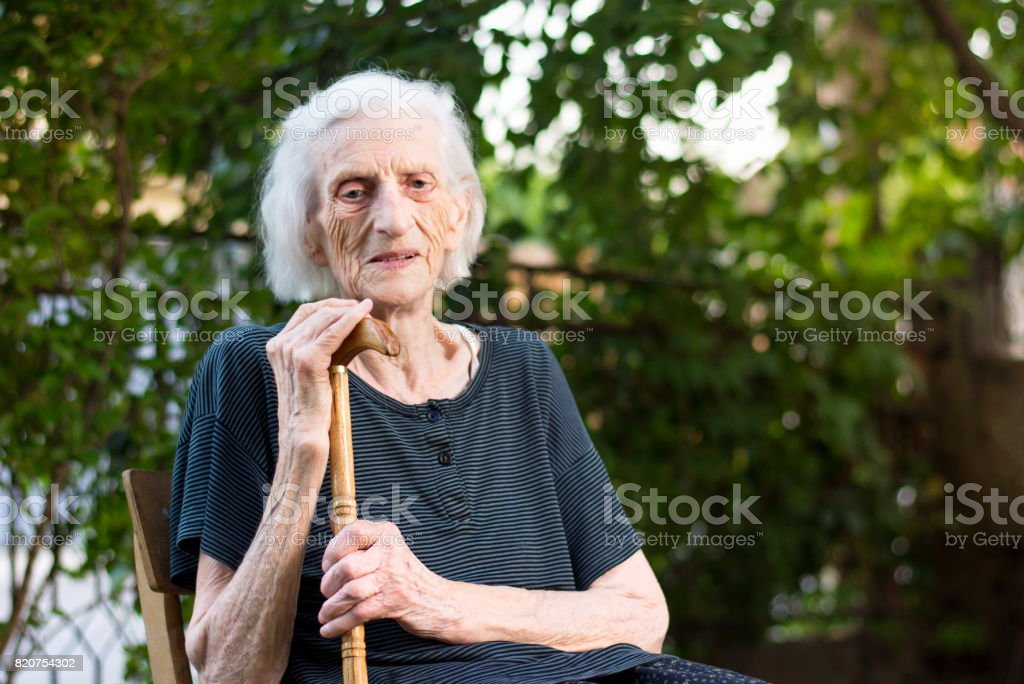 Senior woman with a walking cane stock photo