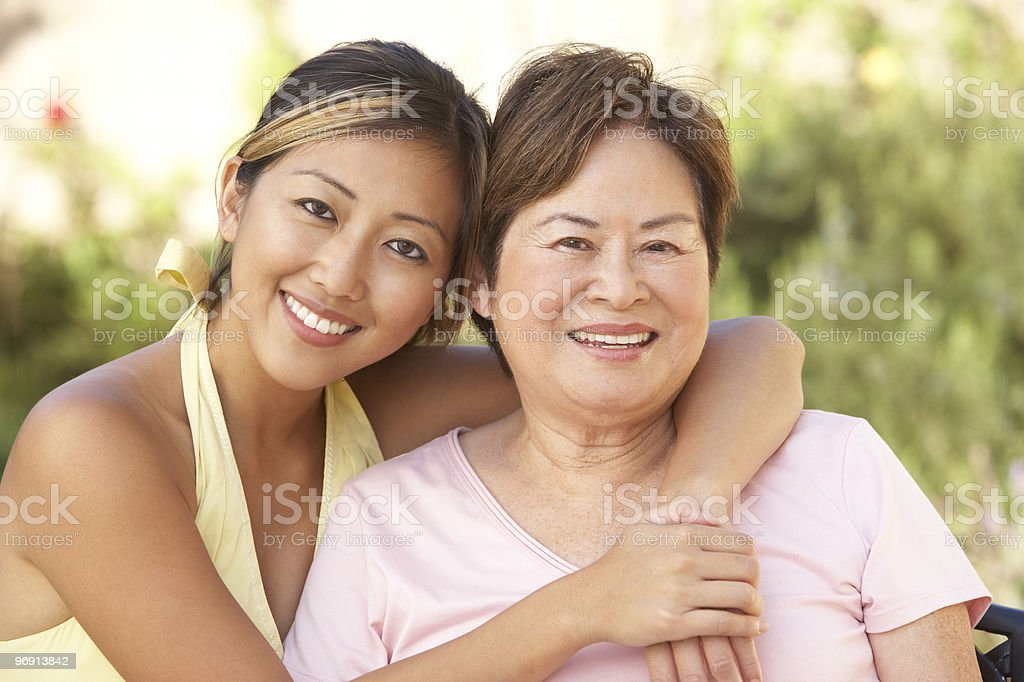 Senior Woman With Adult Daughter In Garden royalty-free stock photo