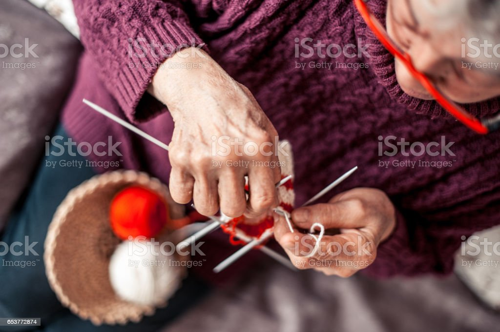 Senior Woman With Arthritic Hands Doing Crochet stock photo