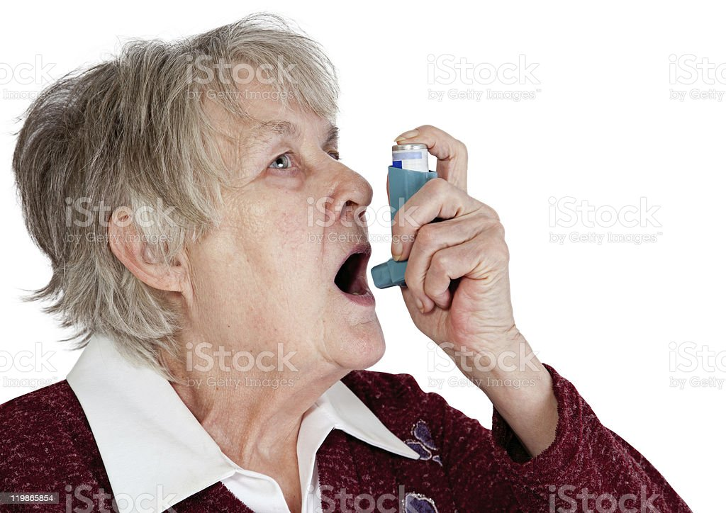 Senior woman with asthma inhaler stock photo