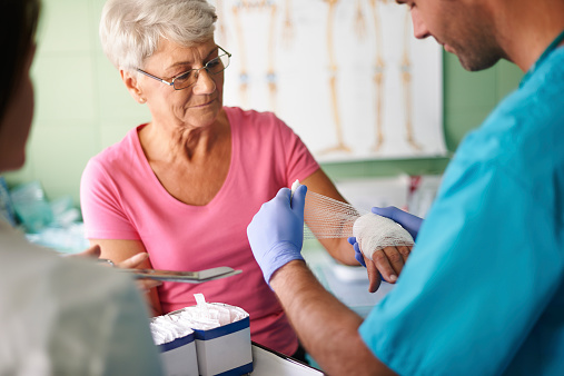 istock Senior woman with bandage on the hand 519407383