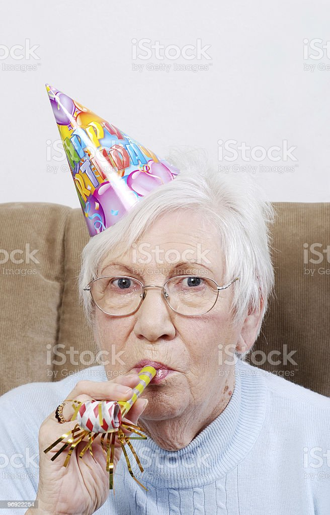 Senior Woman With Birthday Hat And Noise Maker royalty-free stock photo