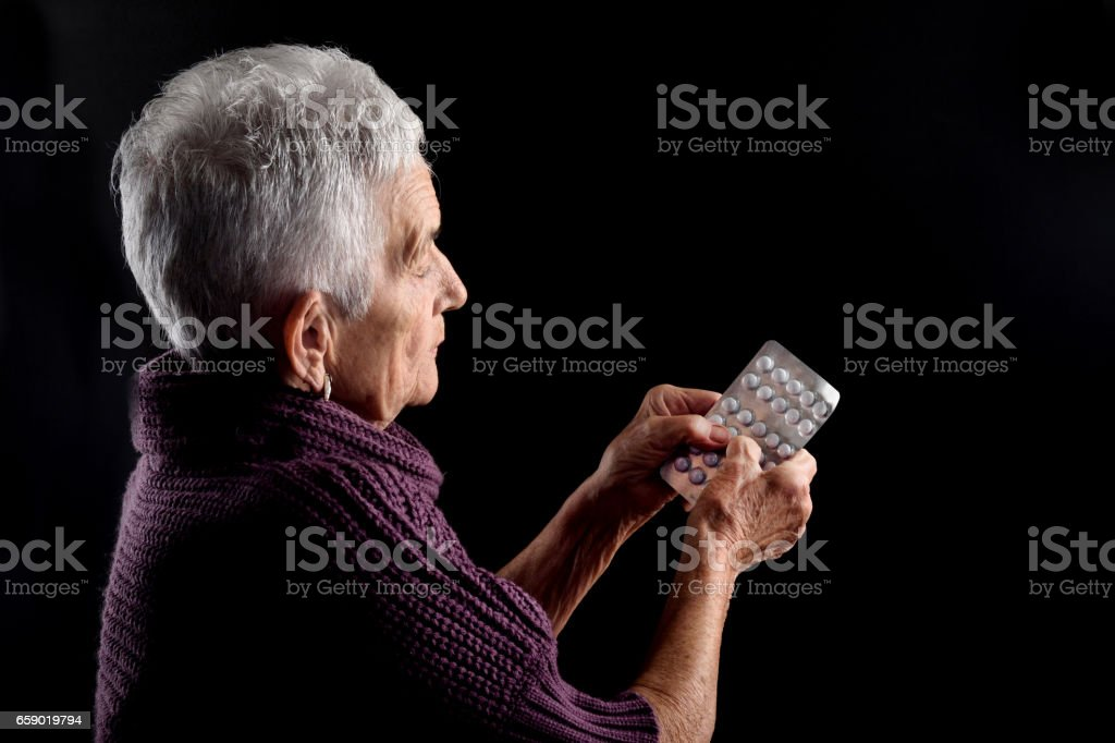 Senior woman with blister medications royalty-free stock photo