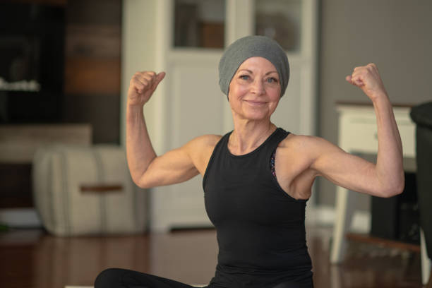 Senior woman with cancer flexing stock photo