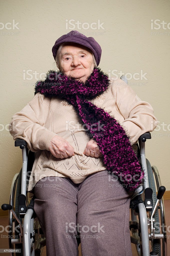 Senior woman with cap royalty-free stock photo
