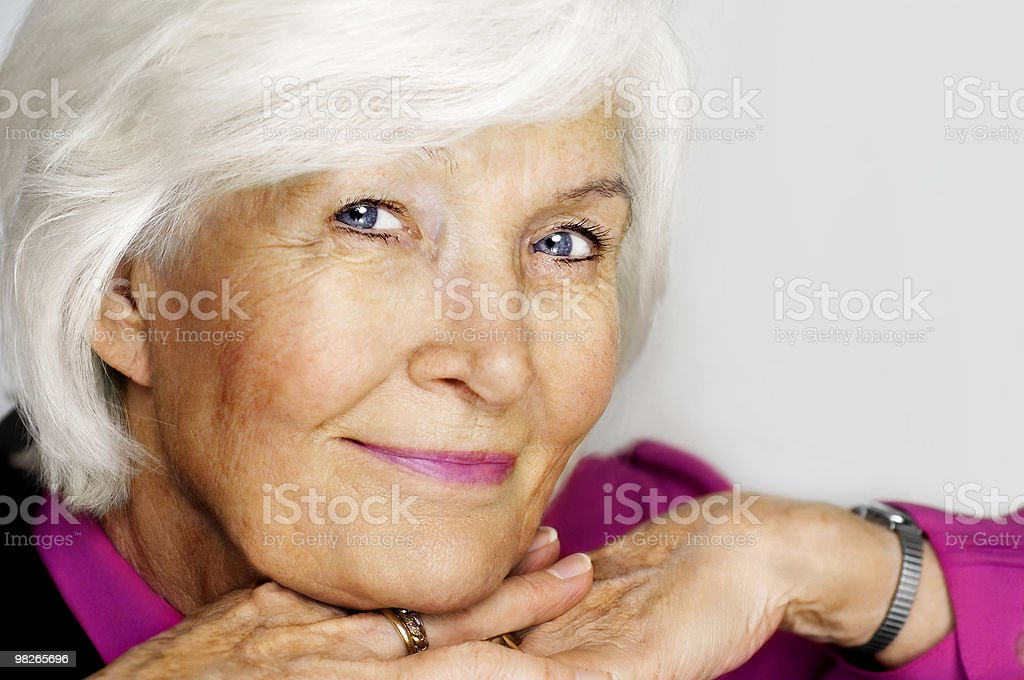 Senior woman with chin on hands royalty-free stock photo