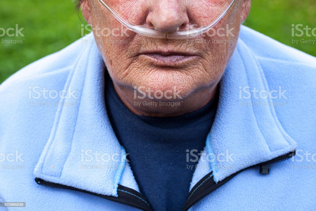Senior woman with Chronic obstructive pulmonary disease with supplemental oxygen stock photo